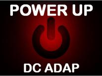 "Close up of a power switch with text ""Power Up, DC ADAP"""