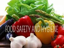 The words Food Safety and Hygiene and a basket of fresh vegetables