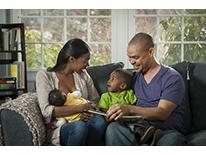 Happy breastfeeding family